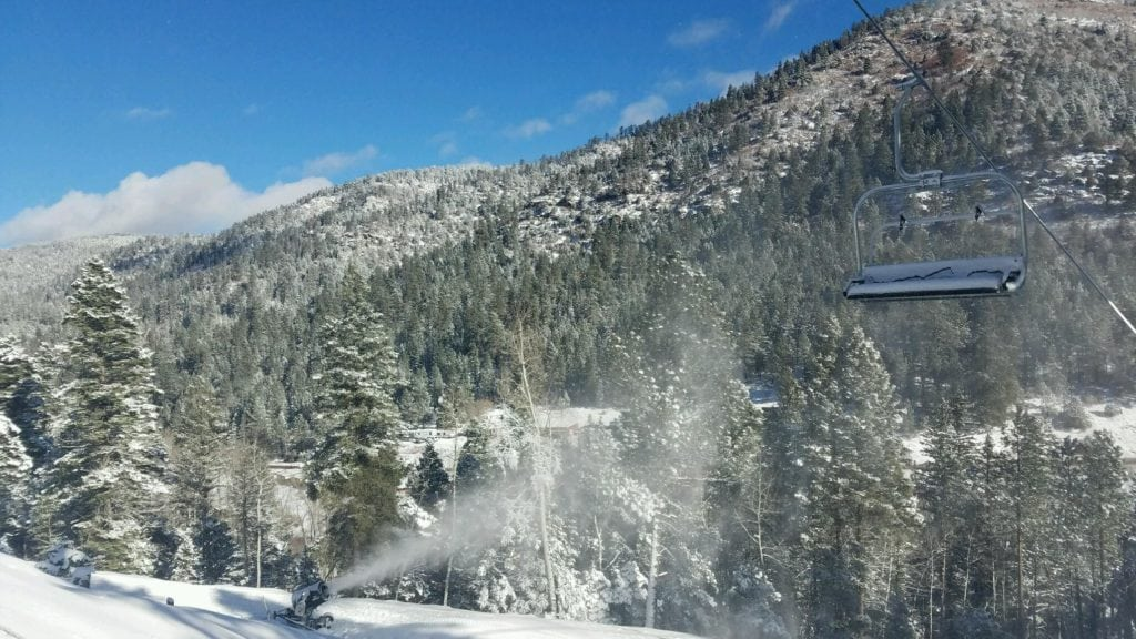 Snowmaking with blue sky