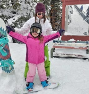 Mom and daughter skiing